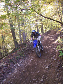 A dirt-biker enjoys the scenery and trail at the SWR Trail Ride